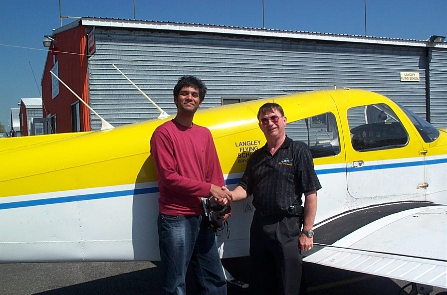 Suraj Canakapalli with Pilot Examiner John Laing after the successful completion of Suraj's Private Pilot Flight Test on May 15, 2008.  Langley Flying School.