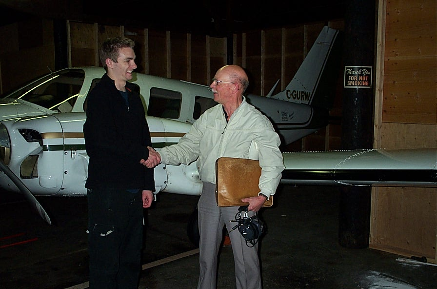 Tim Sawatzky receives congratulations from Pilot Examiner Donn Richardson after the completion of Tim's Multi-engine Class Rating Flight Test.  Langley Flying School.