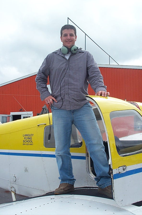 Tony McHale on the wing of Cherokee GODP after completing his First Solo Flight on October 1, 2007, Langley Flying School.