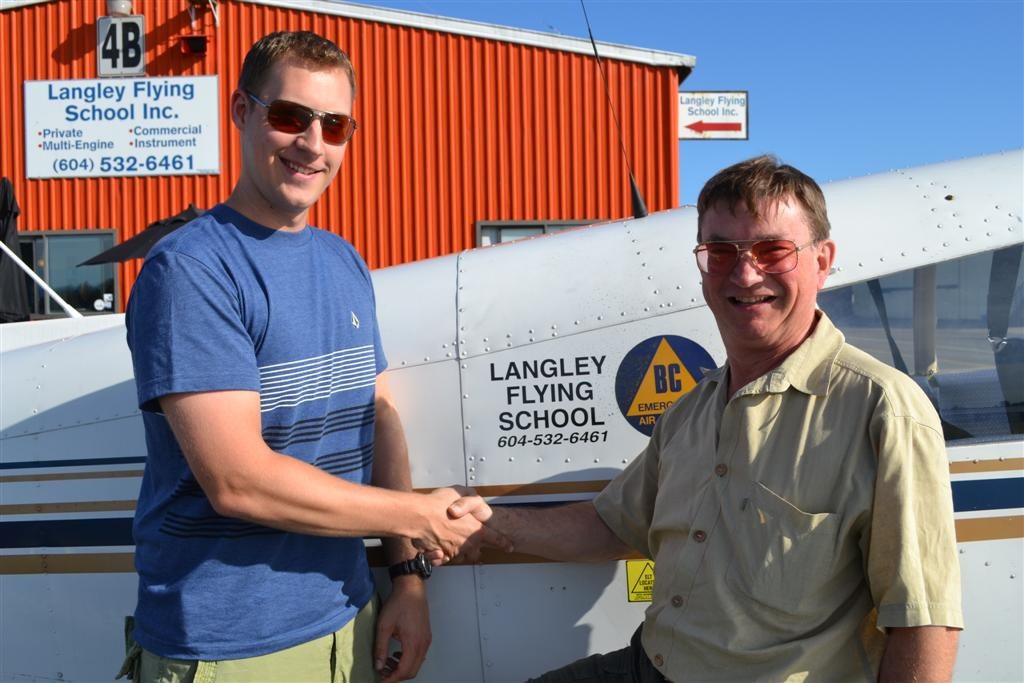 Trevor Conkey receives contgratulations from his Pilot Examiner John Laing, after the successful completion of Trevor's Private Pilot Flight Test on August 1, 2011. Langley Flying School