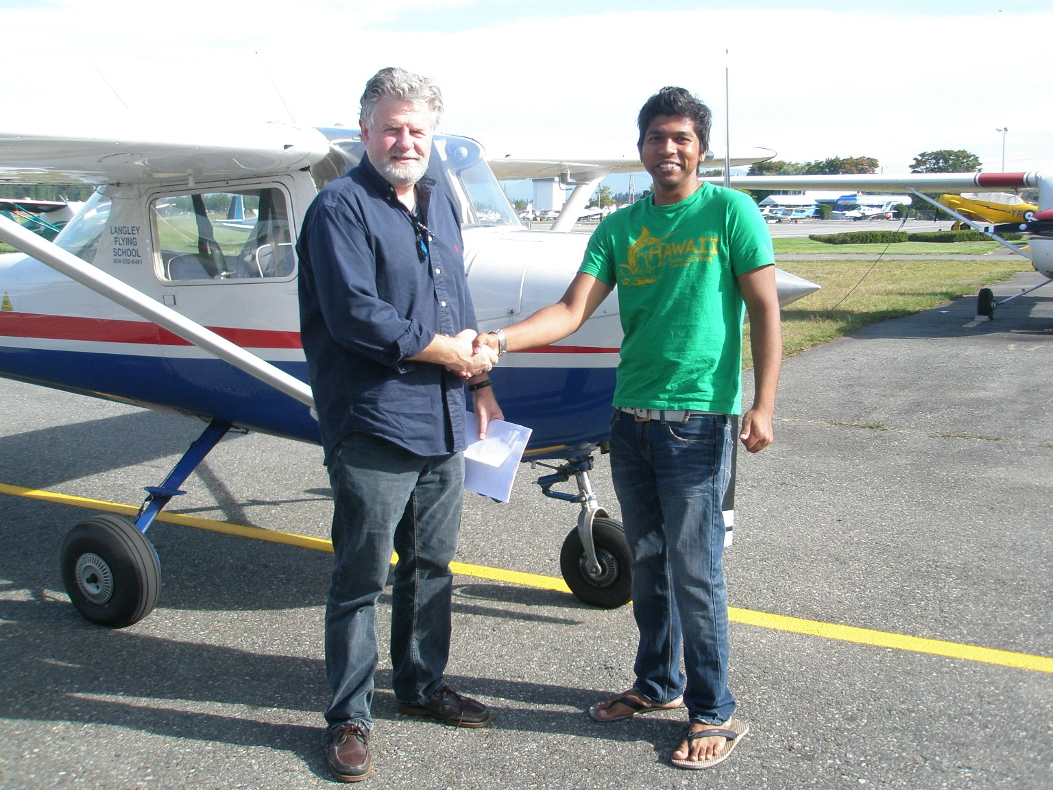Vinit Shinde with Pilot Examiner Paul Harris after the successful completion of Vinit's Private Pilot Flight test on September 21, 2009.  Langley Flying School.