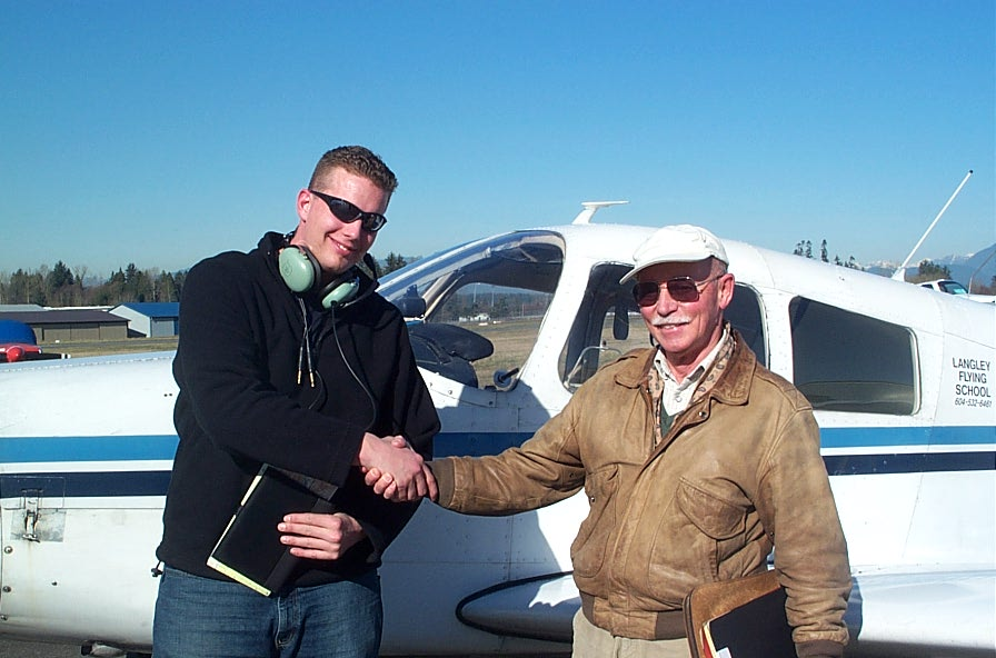 Warren Darby with Pilot Examiner Donn Richardson after the successful completion of Warren's Private Pilot Flight Test.  Langley Flying School