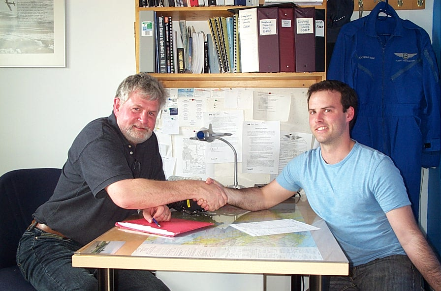 Zenon Garnett receives congratulations from Pilot Examiner Paul Harris after the successful completion of Zenon's Private Pilot Flight Test on April 27, 2009.  Langley Flying School.