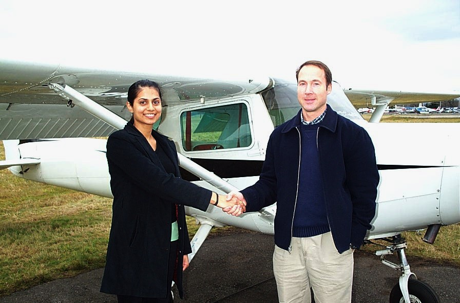 Sukhmani Brar receives congratulations form Pilot Examiner Jeff Durrand after the successful completion of Sukhmani's Commercial Pilot Flight Test on December 21, 2008 in Cessna GPUK.  Langley Flying School.