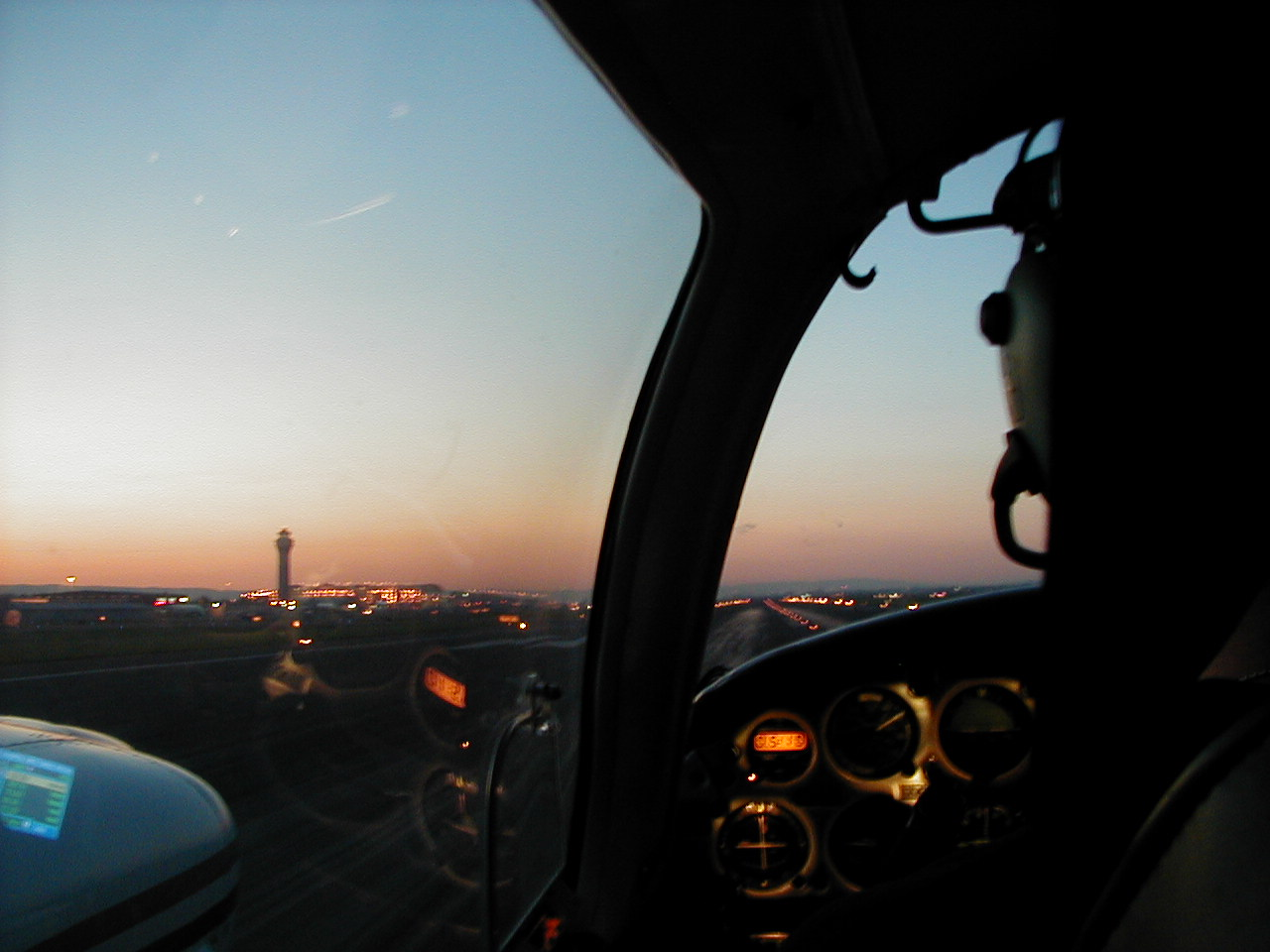 Langley Flying School's Piper Seneca during a twilight departure from Portand International Airport