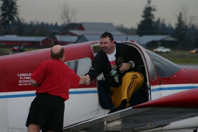 Chief Flying Instructor Dave Parry congratulates Stu Patterson upon completion of Stu's First Solo Flight. Langley Flying School.