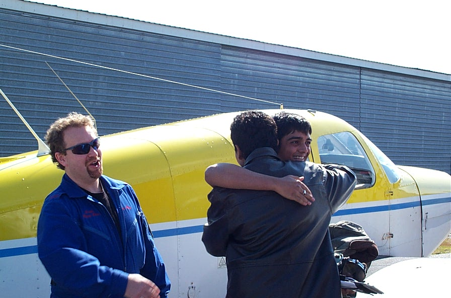 Nikhil Dongare receives contratulations from Pankaj Salve after the completion of Nikhil's First Solo Flight.  To the left is Flight Instructor Dave Page.  Langley Flying School.