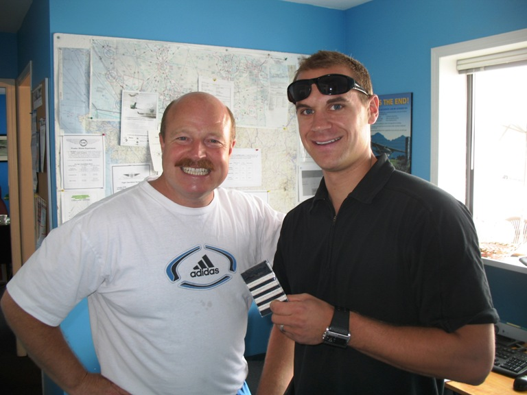 Look at those Captain's Stripes.  Langley Flying School Graduate and Former Flight Instructor, Ryan Gahan, shows Chief Flying Instructor Dave Parry his fresh markers.  Ryan just got promoted from a Saab 340 First Officer to Beech 1900 with Pacific Coastal Airlines.  Ryan is one of three Langley Flying School Graduates currently flying with Pasco.