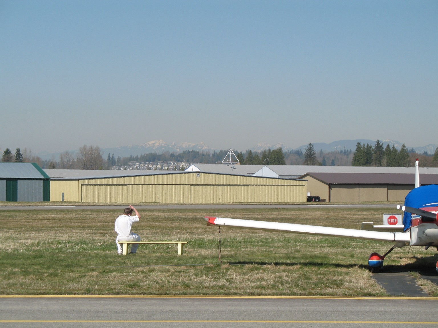 Flight Instructor Philip Craig watching his student, David Marshall, complete his First Solo Landing.  Langley Flying School.
