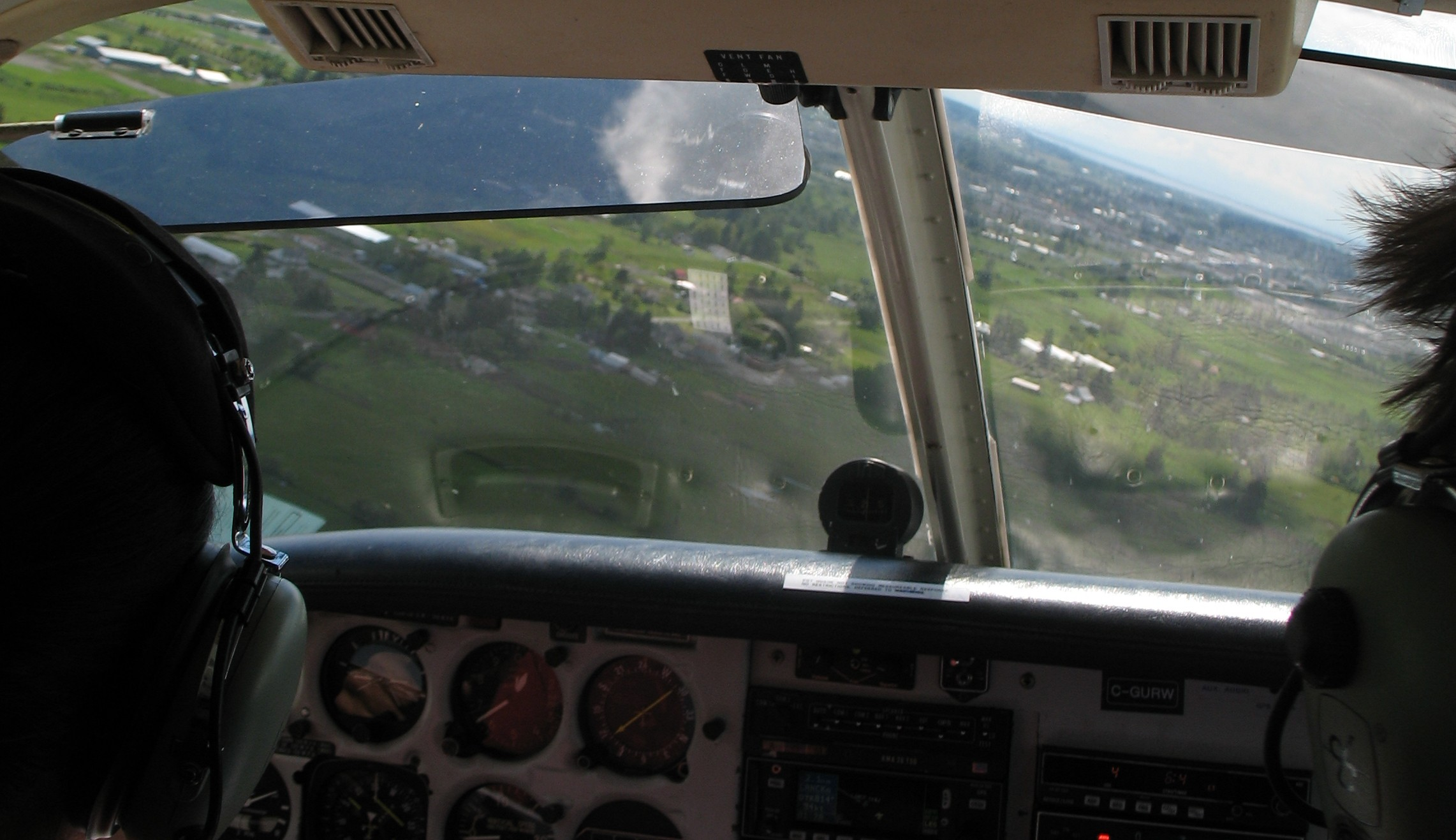 Commercial Pilot Sukhmani Brar rolling out on final approach on to Langley's Runway 19.  Langley Flying School.