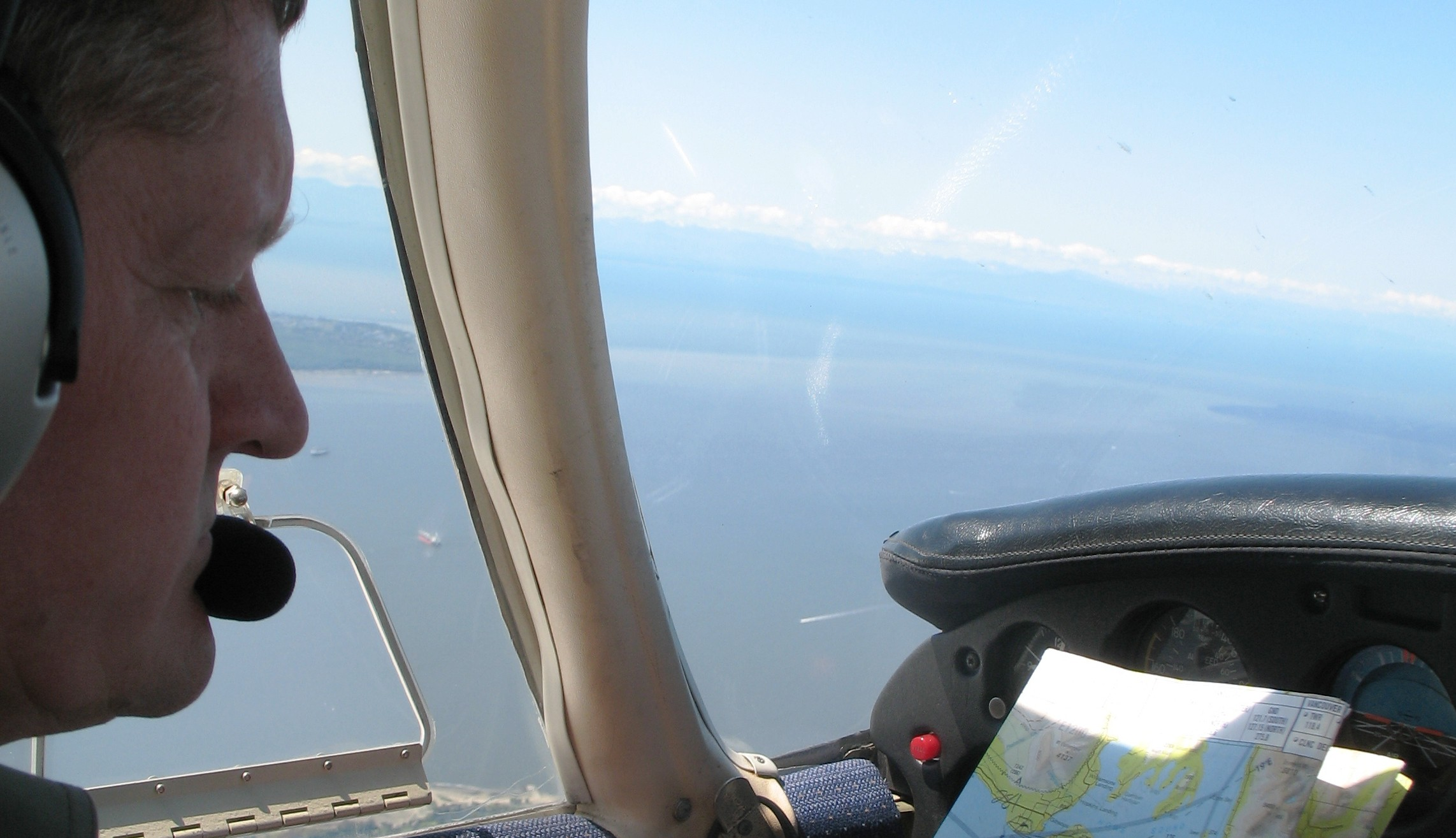 Private Pilot Graduate David Marshall on navigation exercise over the Georgia Strait.  Langley Flying School.