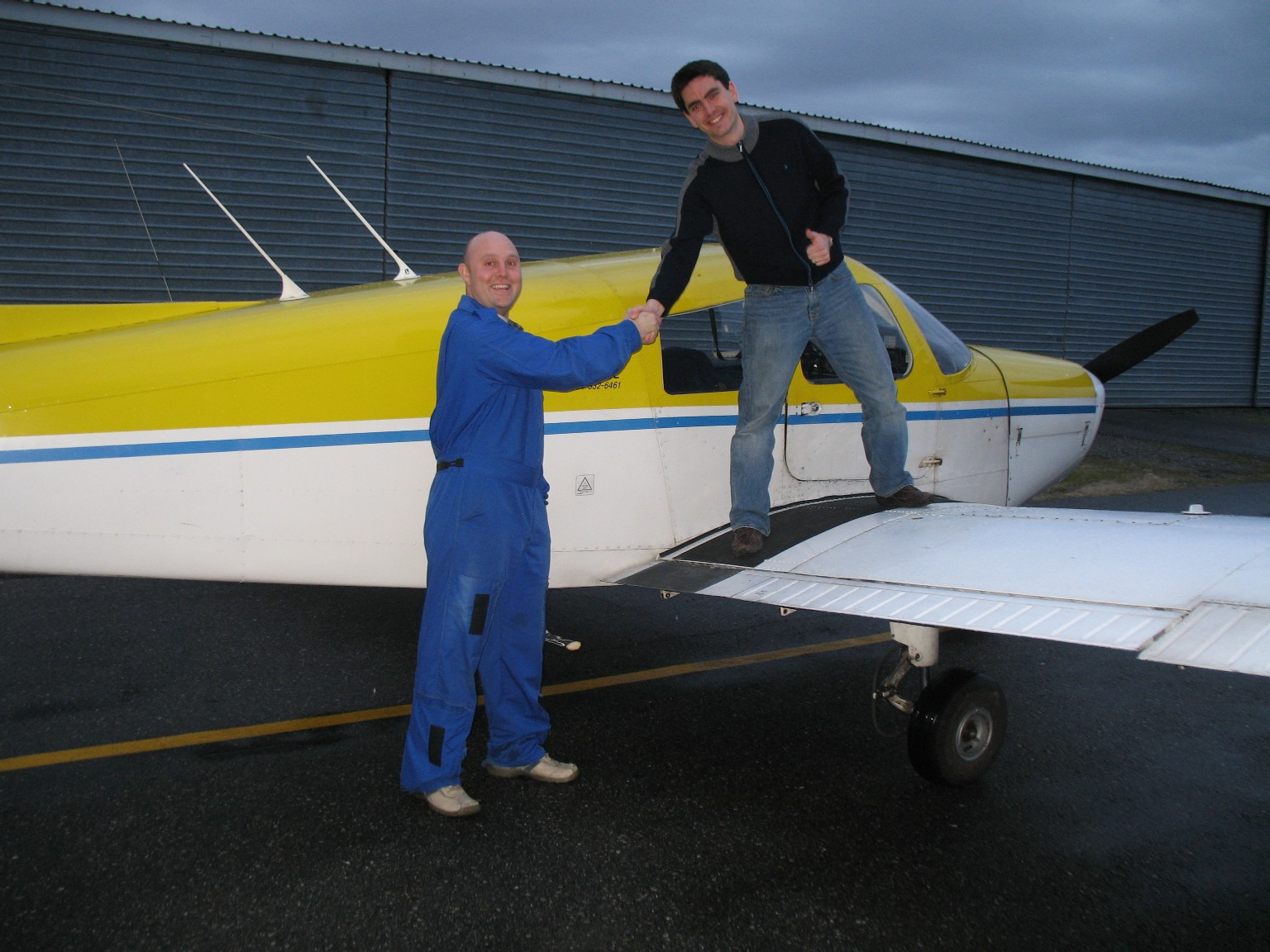 Jonathan King receives congratulations from his Flight Instructor, Rod Giesbrecht, after the completion of Jon's First Solo Flight on January 25, 2009 in Cherokee GODP.  Langley Flying School.
