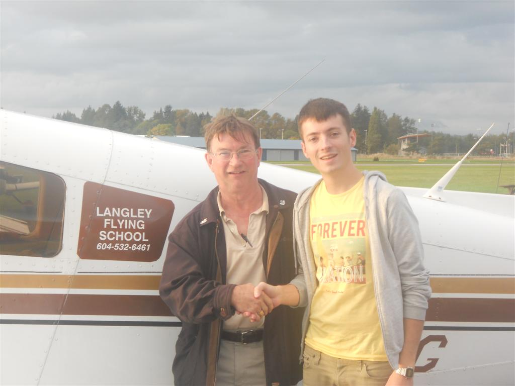 Florian James with Pilot Examiner John Laing after the successful completion of his Commercial Pilot Flight Test on October 12, 2011. Langley Flying School.